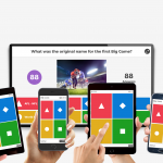 Students holding small devices while looking up at the main Kahoot! game screen